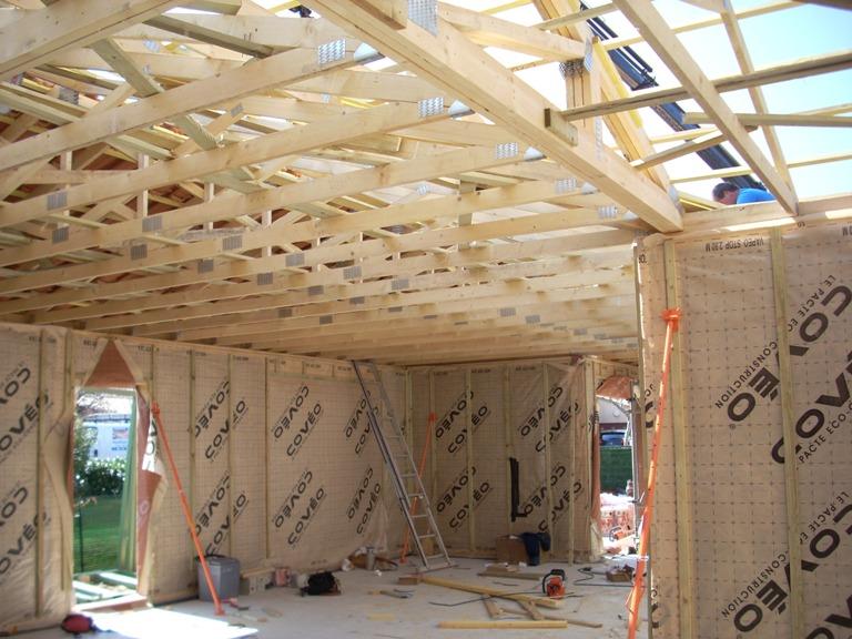 charpente maison bois,montage charpente,charpente fermette,chantier maison ossature bois toulouse