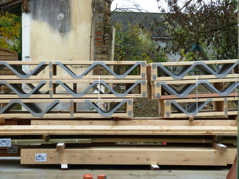 Chantier maison bois construction bois agrandissement en for Construction plancher bois etage
